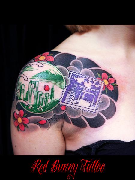 駅のスタンプと和彫り 女性の刺青